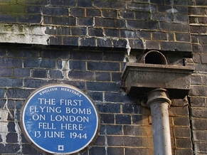 Mile End, the first flying bomb on London fell here June 1944