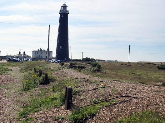 Picture of Remains of derelict Dungeness Railway Station platform closed in 1937 with lighthouse in background