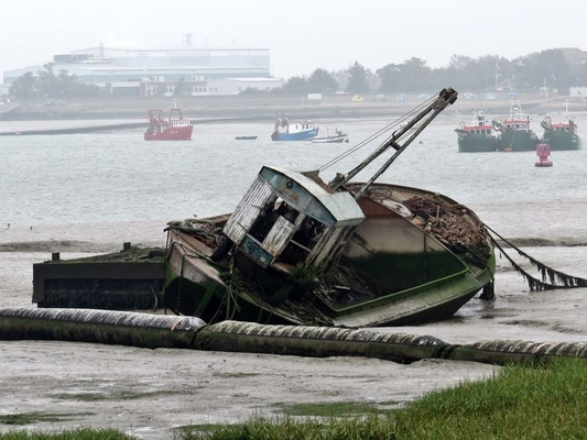 Picture of abandoned boat at Queenborough on Isle of Sheppey,Kent  beside boat breakers yard once served by railway sidings