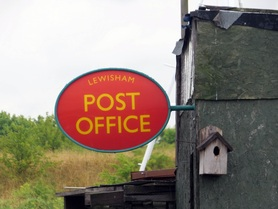 Picture of Lewisham Post Office sign at dilapidated building in boatyeard at Swancombe Marshes