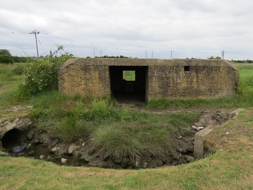 Picture of Derelict Pillbox at Hoo Stop Line. The line across the Hoo peninsula took the form of an artificial anti-tank ditch dug to join the Medway and Thames rivers. This was supported by pillboxes, anti-tank rails and road blocks.