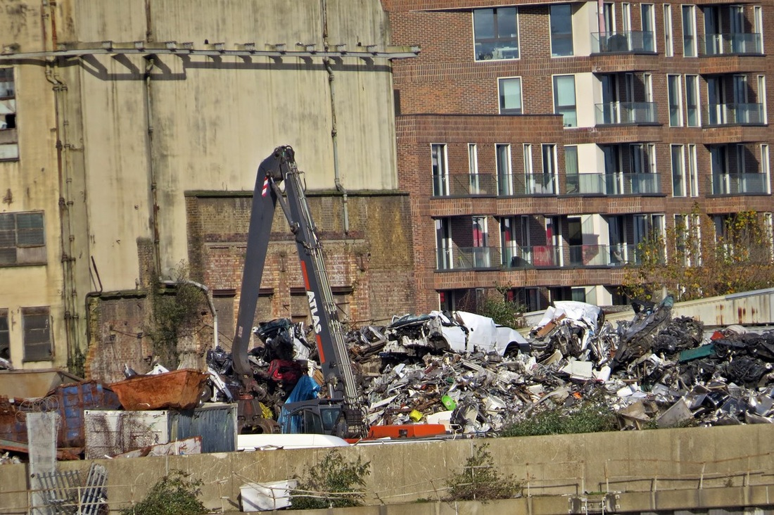 Picture of scrap metal works on industrial site next to new build flats in Silvertown, E16