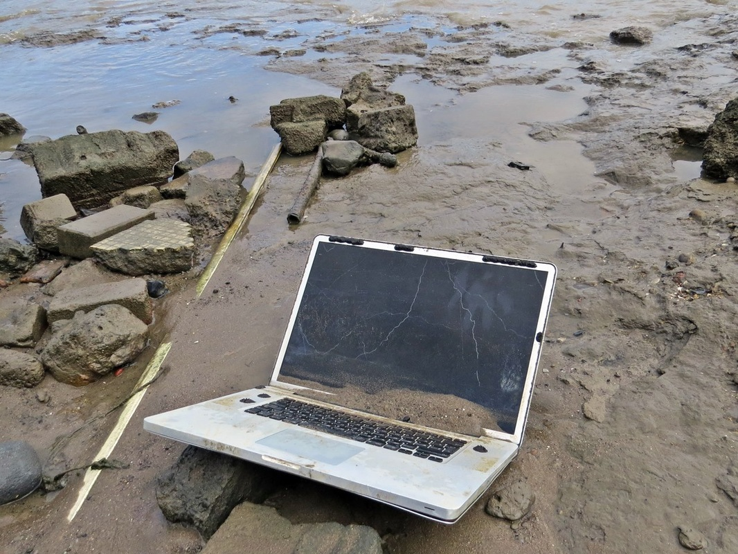 Picture of abandoned laptop in the River Thames on the foreshore in Deptford, SE8