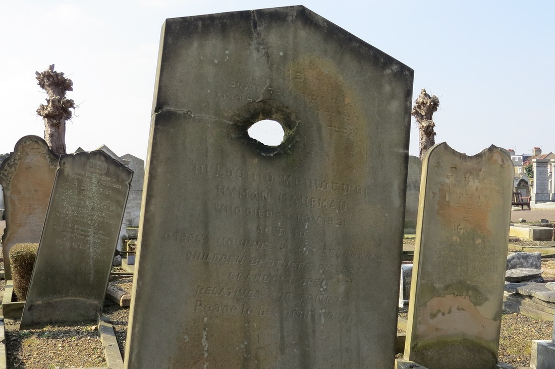 damaged headstones in East Ham Jewish Cemetery which he believes to be shrapnel damage or bullet holes from a dogfight