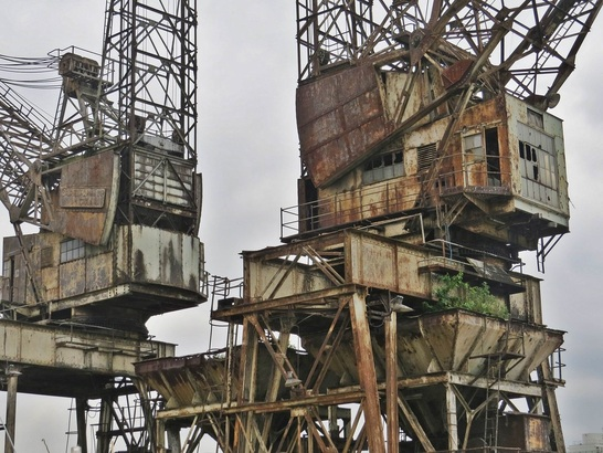 Derelict London Battersea Power Station - The jetty facilities used these two cranes to offload coal, with the capacity of unloading two ships at one time