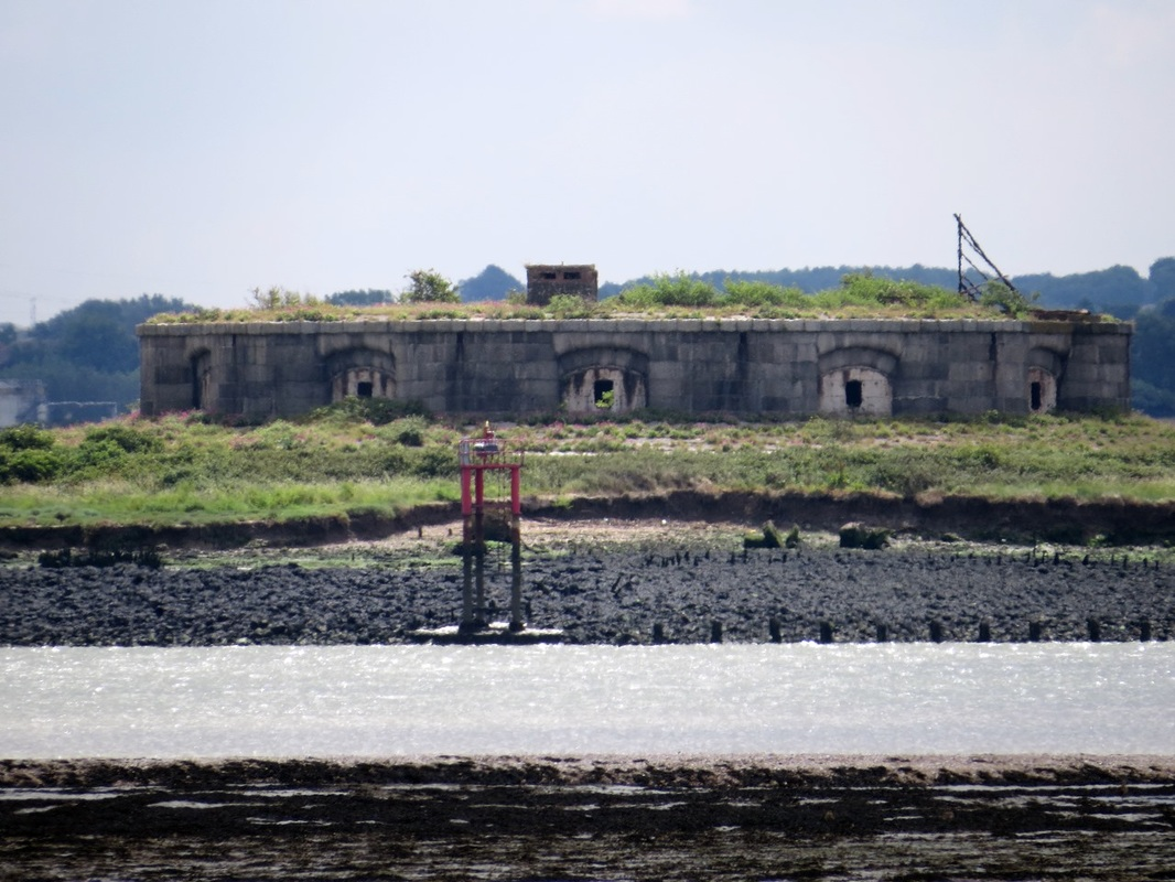 Picture of The derelict Hoo Fort on the Medway.Disarmed before the First World War. In the Second World War, the fort was used as observation posts, with platforms and pillboxes built on top.