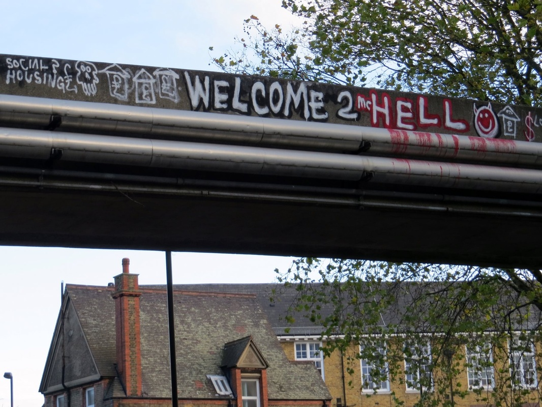 Welcome to Hell graffiti on derelict walkway in Walworth South London