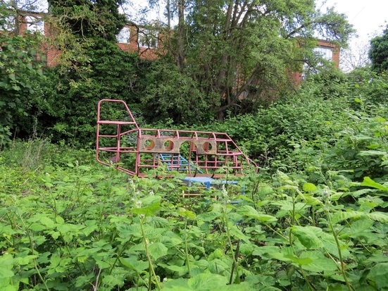 The abandoned Tyneholme Nursery & Headstone Centre, a pre school language centre In Harrow. The playground is overgrown and the buildings are in a derelict state