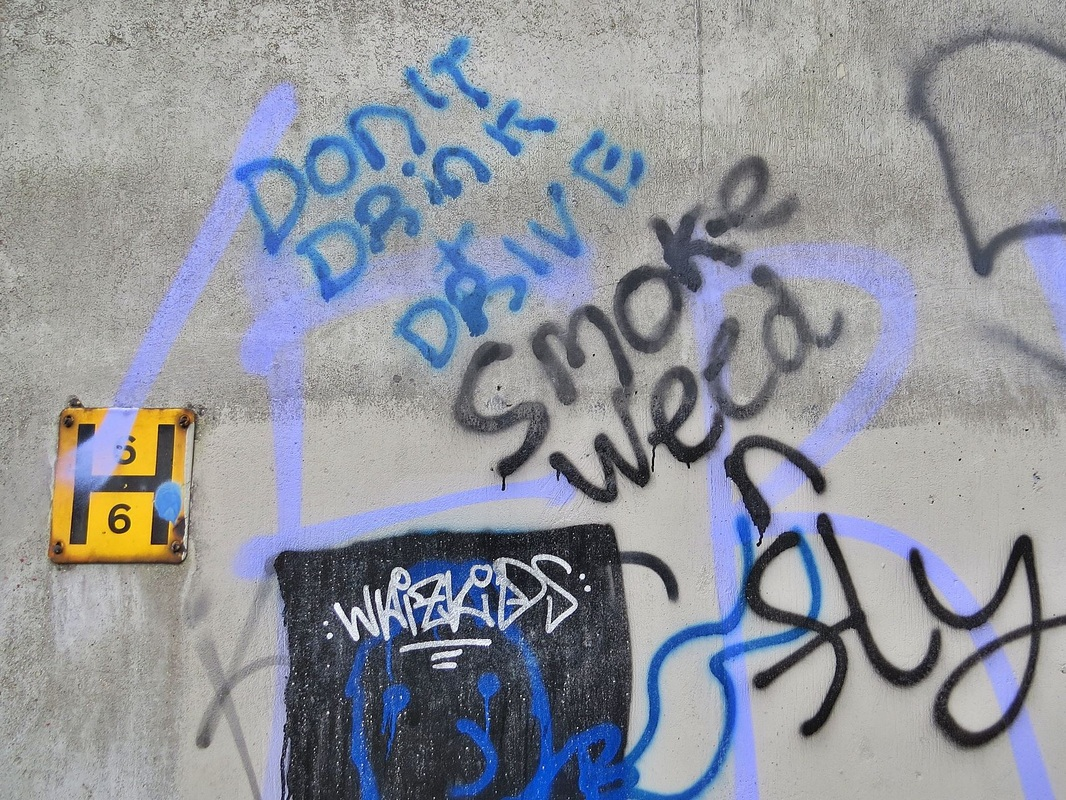 Graffiti in abandoned Heygate Estate in Walworth. Dont drink and drive smoke weed