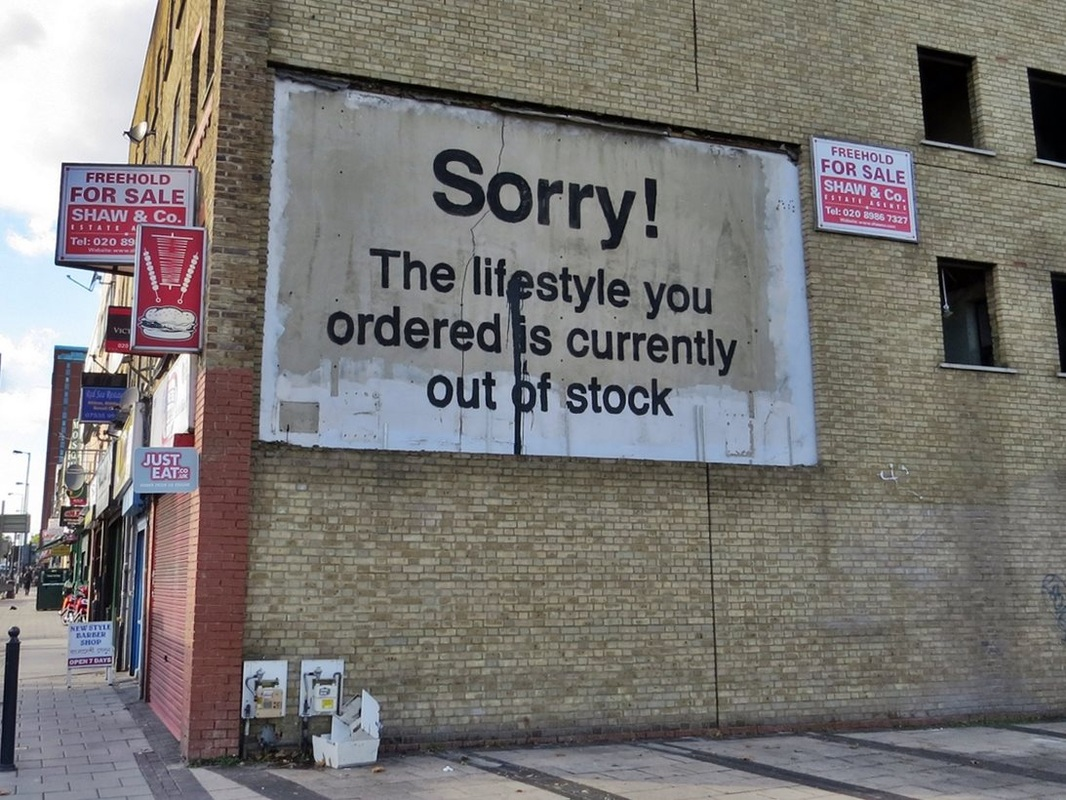 Banksy streetart on empty building in Poplar, East London. Sorry! The lifestyle you ordered is currently out of stock