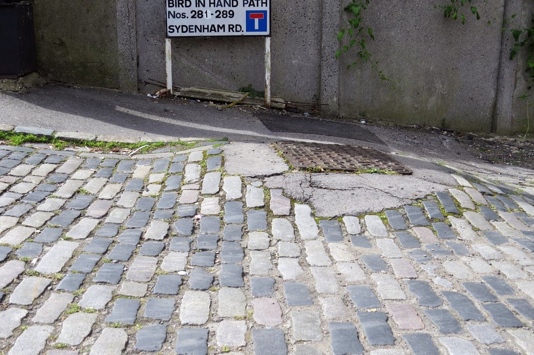 Cobbles of Bird in Hand Path beside the ex canalside pub of the same name
