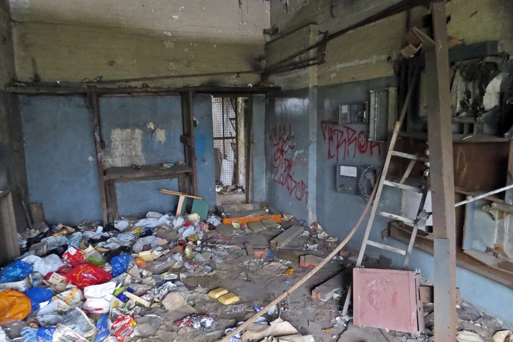 flytipping and squatters' rubbish left in derelict building in East London