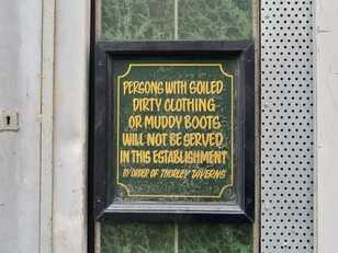 Persons with dirty clothing or muddy boots will not be served