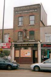 Earl Grey boarded up pub  in Bethnal Green Road now  clothes shop called Shazna Collection
