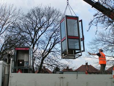 Redundant BT phonebox being removed in North London