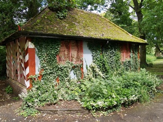 Overgrown derelict public toilet in London