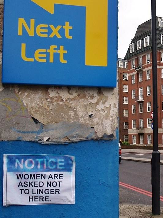 Women are asked not to linger here - sign on the Finchley Rd, St Johns Wood