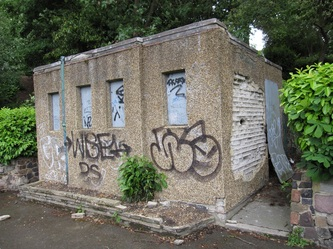 closed down and derelict concrete public toilet block in London