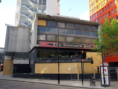 The closed down Intrepid Fox rock pub on St Giles Street behind Centrepoint soon to be demolished to make way for redevelopment as Crossrail drives up property values