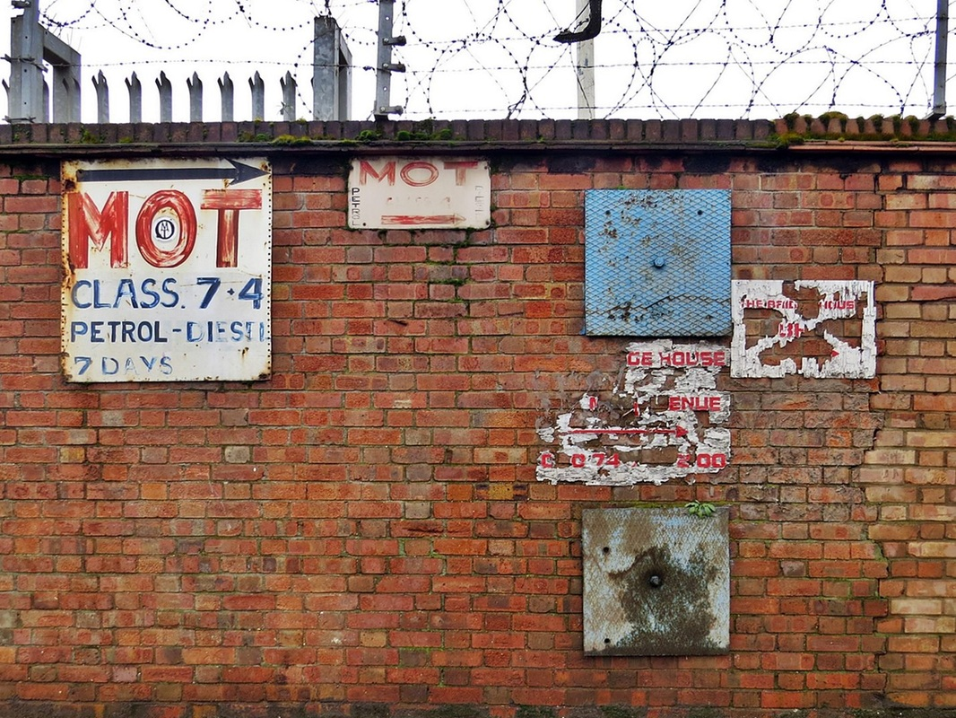 Fading signs in Bidder Street in Canning Town