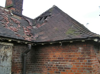 Falling roof tiles on public toilet in South London