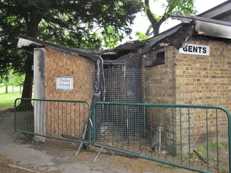 Derelict and fire damaged  London toilets in a South London park