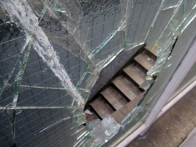broken glass of smashed window in public London toilets