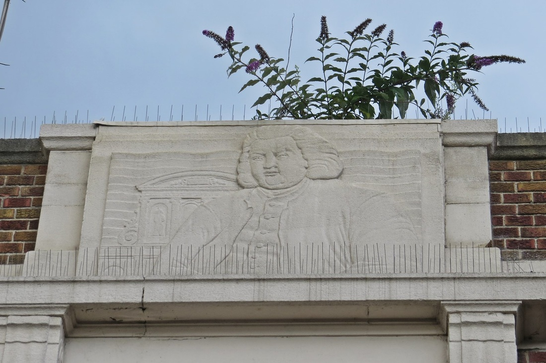 Picture of detail above the entrance of decaying Barkingside pub. closed in 2010 after a long running legal dispute between the pub company and its tenants.