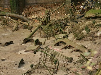 dumped supermarket trolleys on the Thames foreshore in Charlton, South London