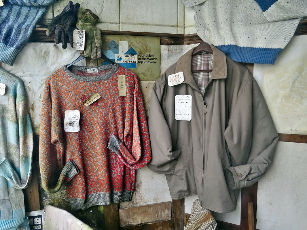 fading window menswear display in Myddleton Rd, Bowes Park now owned by ex Killing Joke member