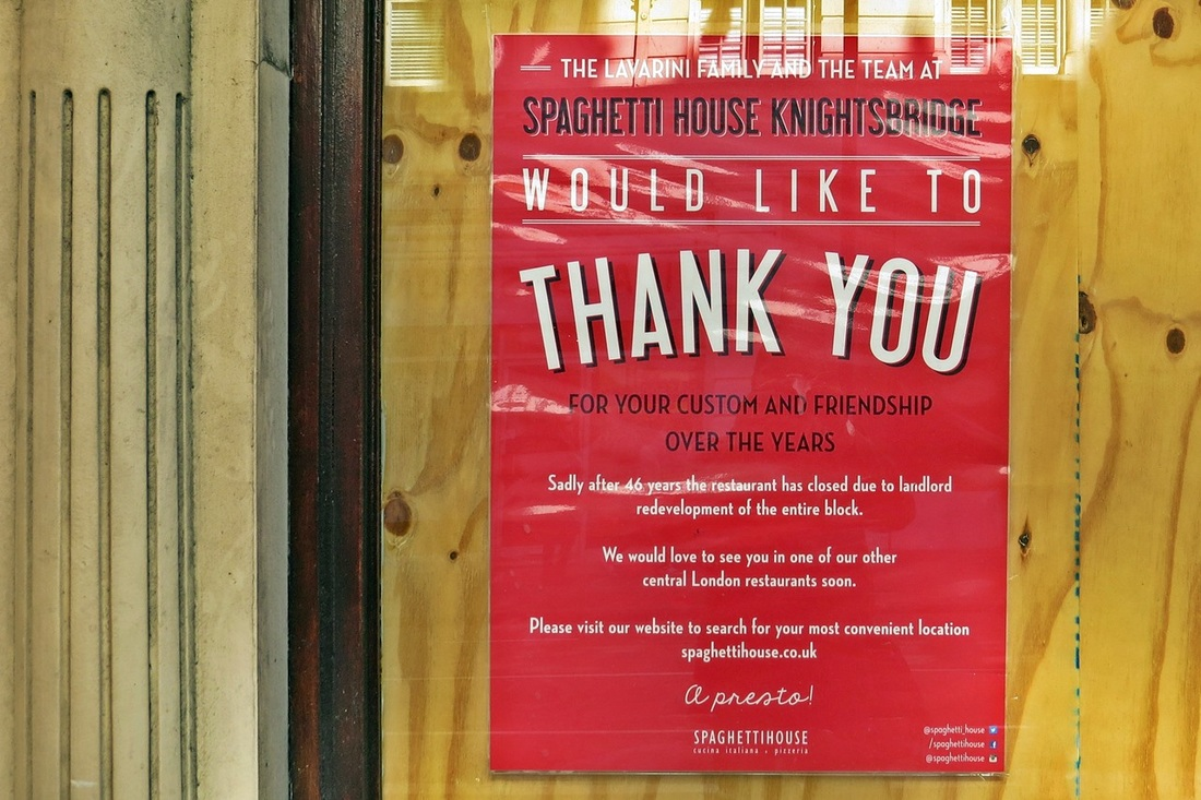 Picture of farewell poster on boarded up Spaghetti House in Knightsbridge