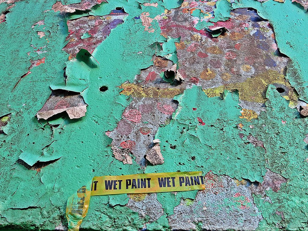 Wet paint sign on peeling surface in Muswell Hill, N10