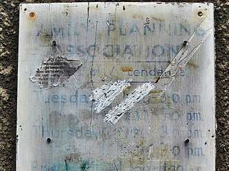 A faded old Family Planning sign was visible on the front of the building