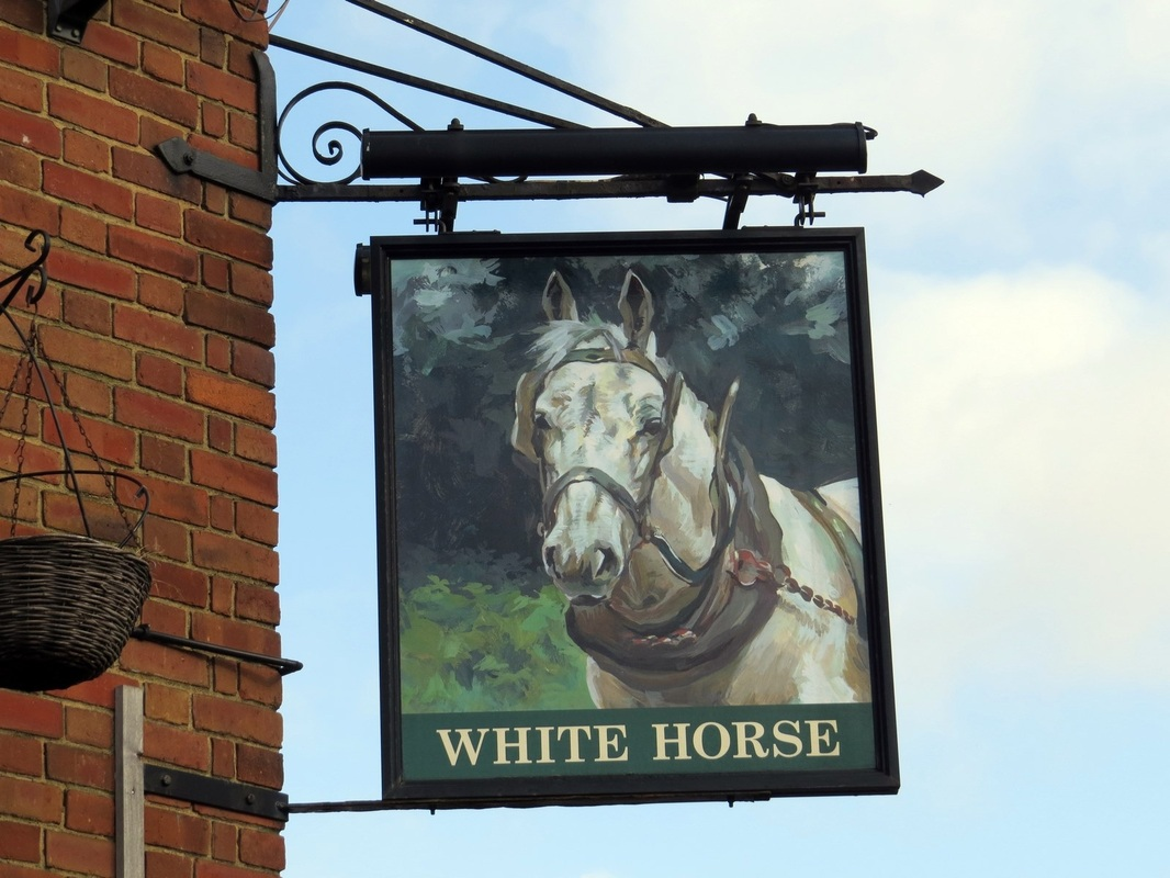 Pub sign of the closed down White Horse in Barking