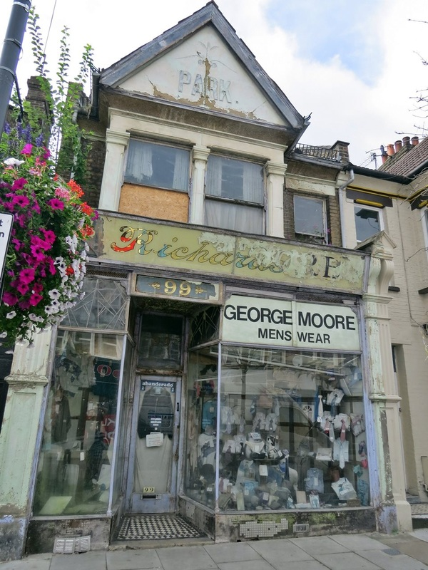 The abandoned looking mens clothese shop of George Moore Menswear - Bowes Park, N22