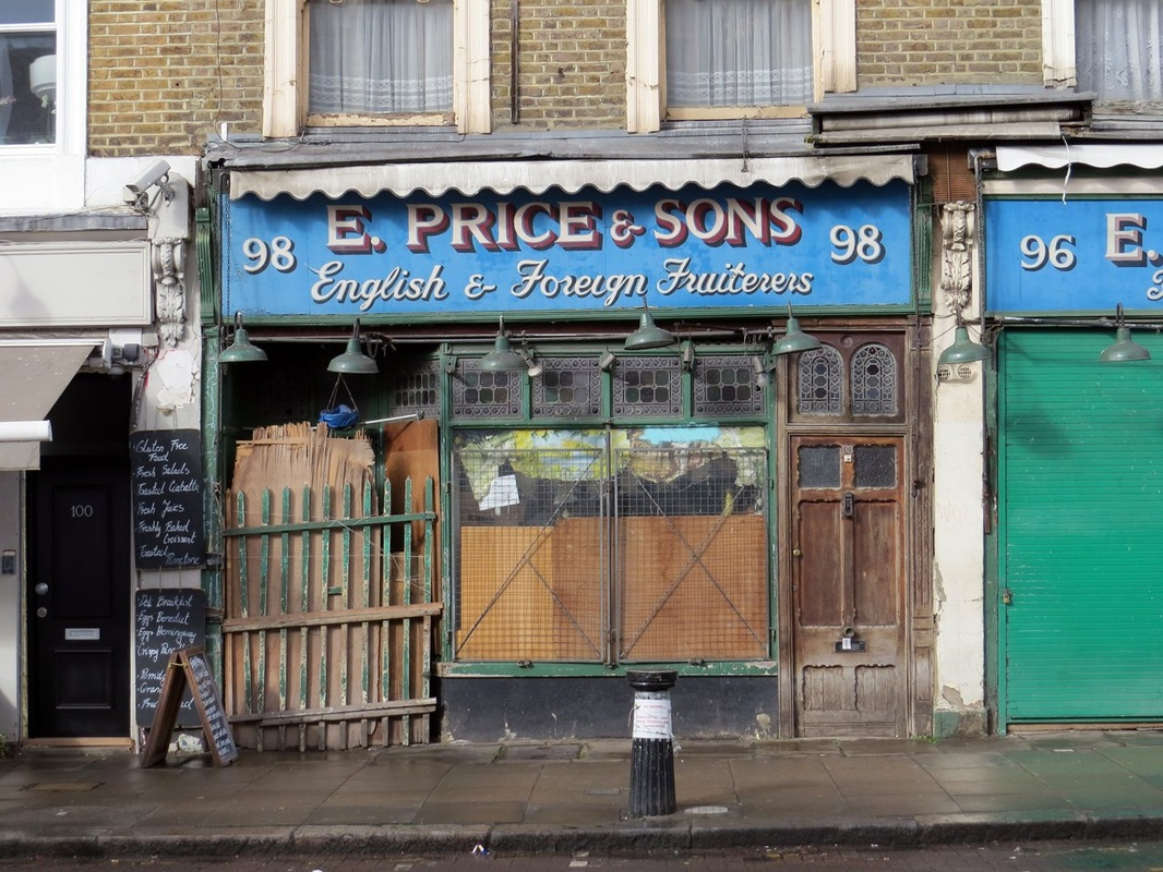 derelict closed down fruit and veg shop in Golborne Rd in London  W10