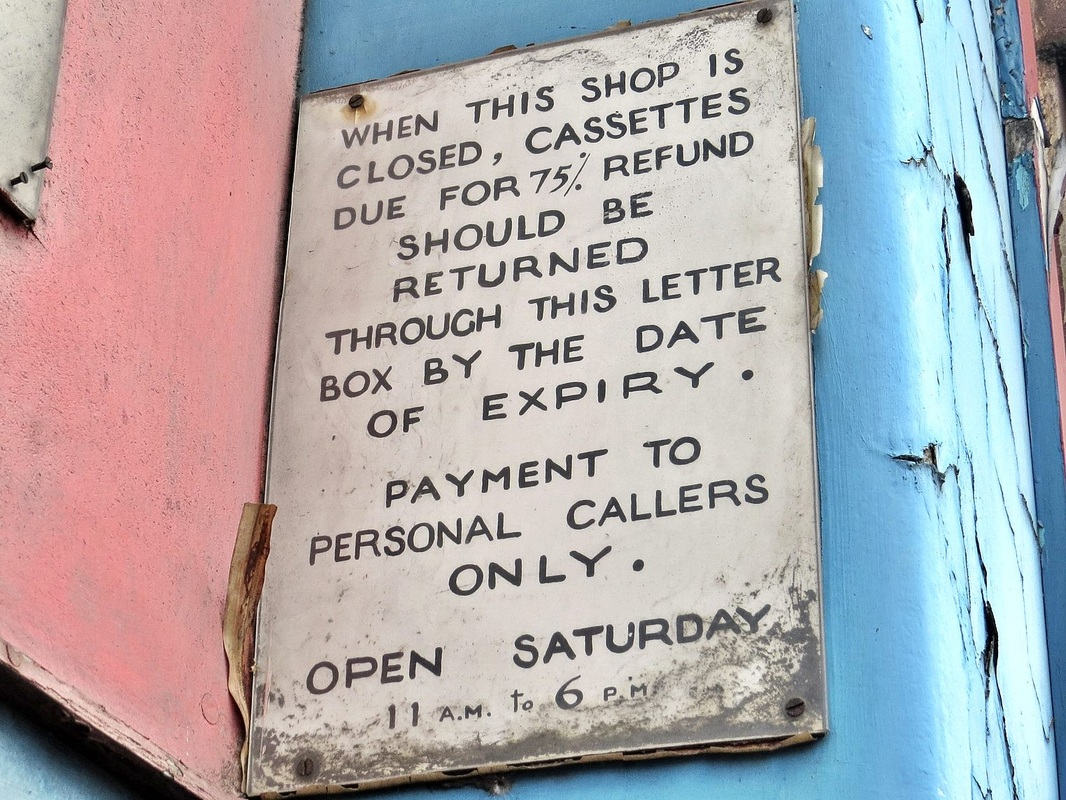 Old  sign about  audio cassette refunds  outside the abandoned Zodiac Record Shop in Wandsworth on the one way system