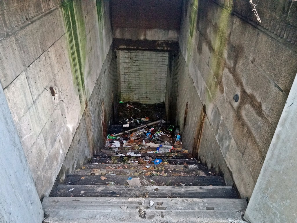 Derelict stairwell down to subterranean public toilets in Archway, North London