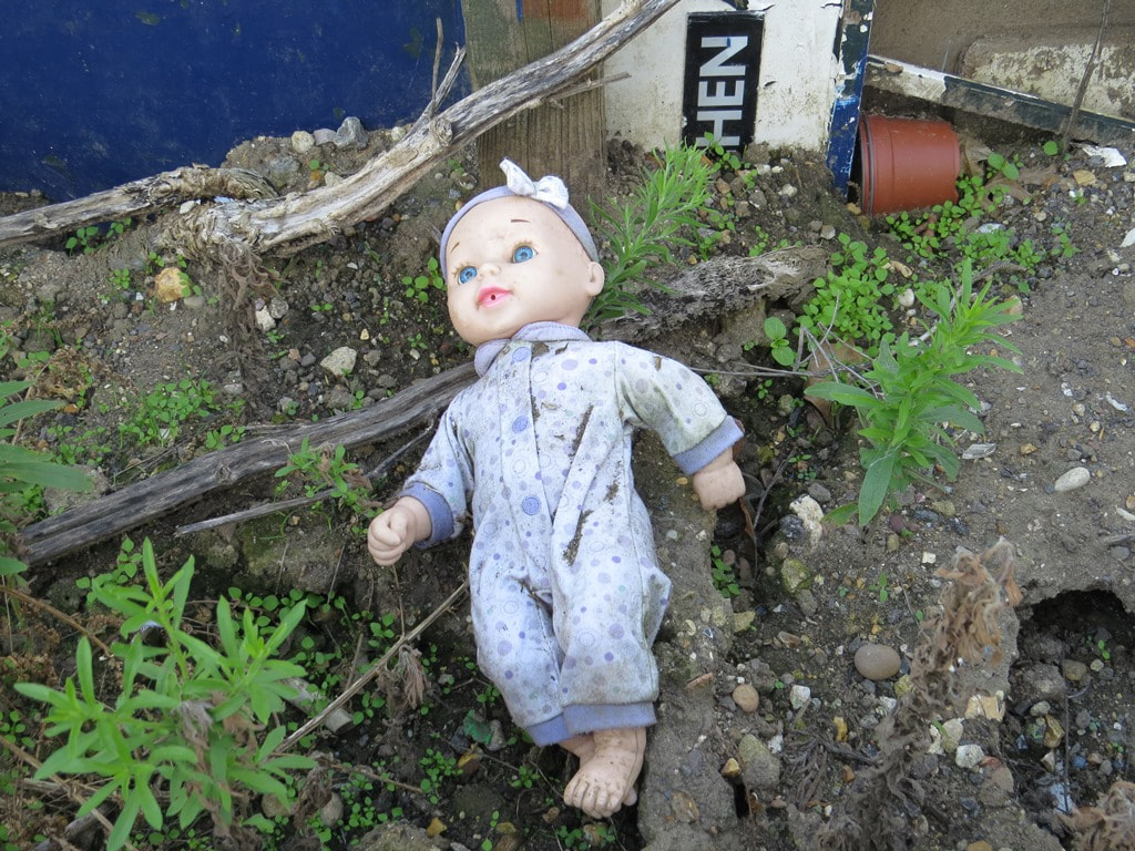 Abandoned child's doll at the back of the Bitter End derelict gig venue and pub in Romford, East London