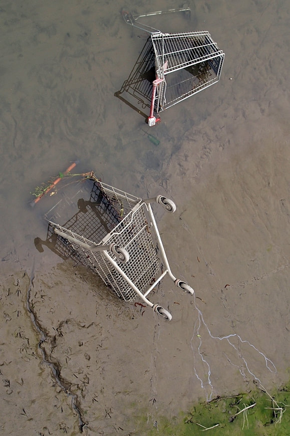 Abandoned supermarket shopping trolleys disposed of in the River Darent in Dartford