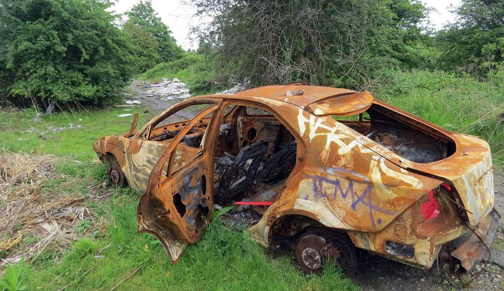Picture of burnt out stolen and abandoned car in Dartford on Joyce Green Lane