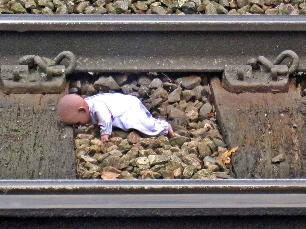 Baby doll discarded onto railway line in East Dulwich, South London, SE22
