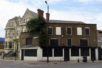 The Coach & Horses on the High St closed down and derelict. Another of London's abandoned pubs