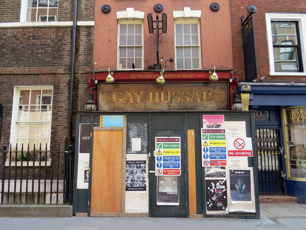 The closed down boarded up Gay Hussar restaurant in Greek St, Soho