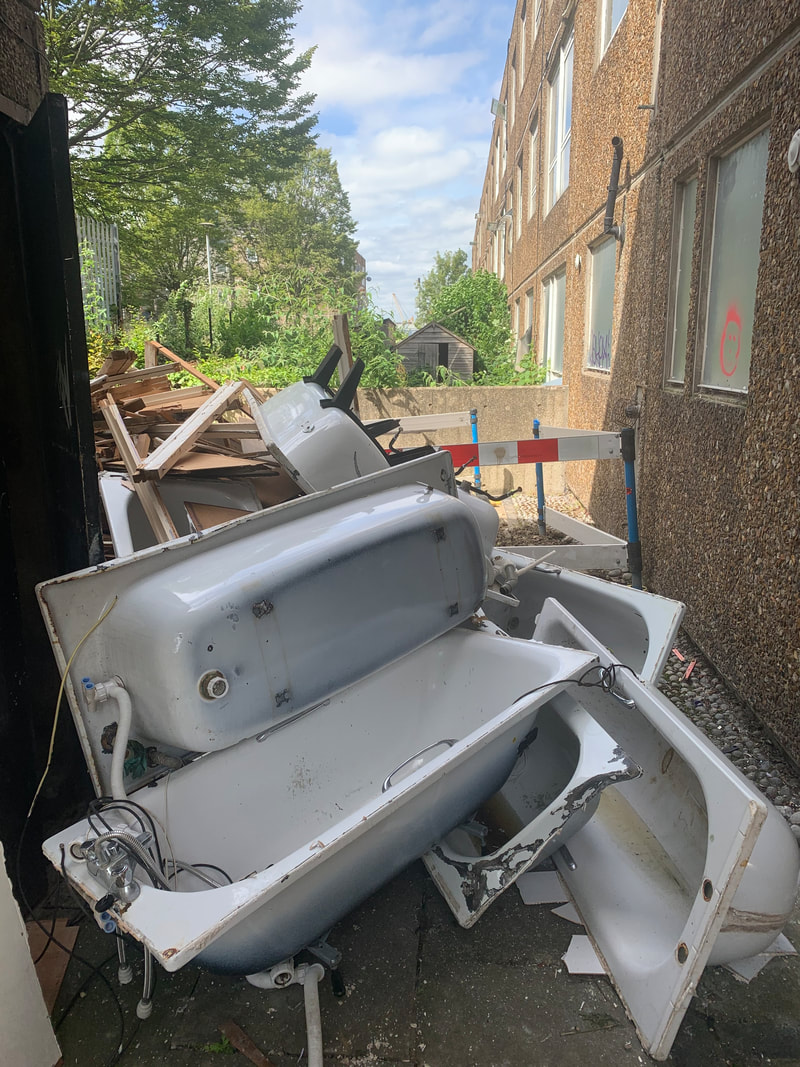 Picture of bathtubs on derelict Morris Walk Estate in Woolwich, SE London