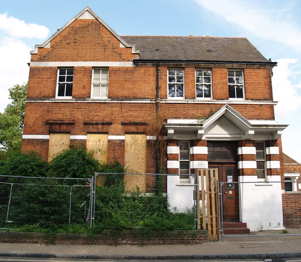Picture of Thomson House School when it was the derelict Level Crossing Centre in Mortlake