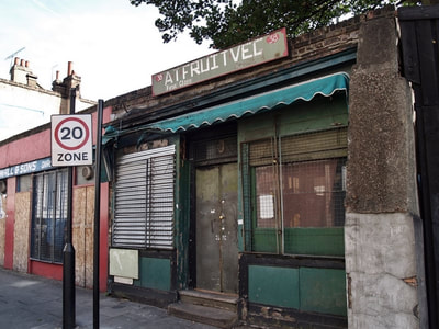 Closed down fruit and veg shop in Stepney, East London
