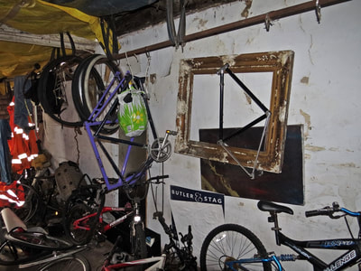 Abandoned bike workshop in derelict shop on Commercial Road, E14