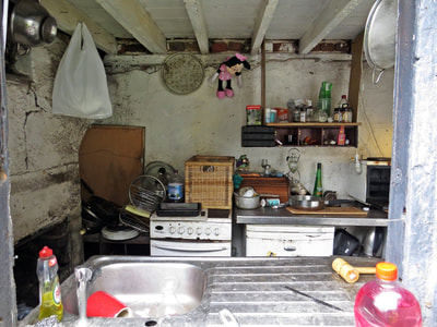 kitchen in abandoned closed down shop in Limehouse on the A13