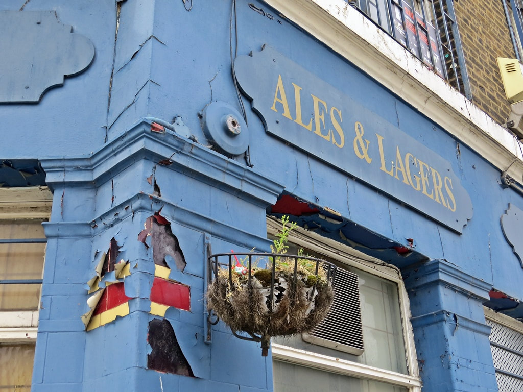 Ales and lagers sign on closed down derelict pub Lord Palmerston Deptford